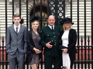 Running Paramedic recieves Queens Honour family