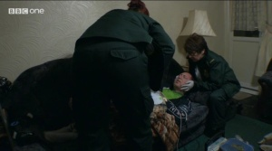 Julie treating a man with a serious neck injury