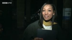 Maya with her graduation certificate