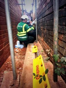 MAN FALLS FROM SCAFFOLDING AND LANDS IN TIGHT SQUEEZE IN BIRMINGHAM