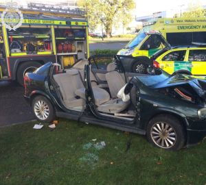 03-11-14 - WOMAN CUT FREE AFTER CAR COLLIDES WITH TREE