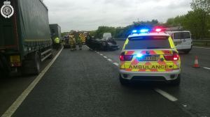 Car on roof on M40 1
