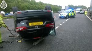 Car on roof on M40 2