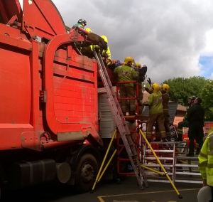 Man rescued from refuse collection lorry