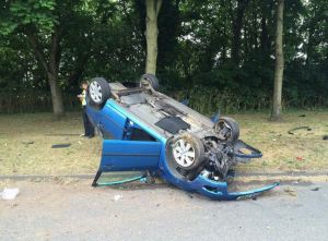 RTC leaves car upside down and woman injured in Coventry