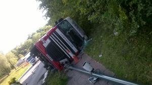 Driver injured as lorry overturns