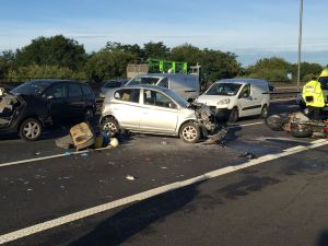 MOTORCYCLIST LEFT TRAPPED UNDER CAR IN RUSH HOUR M6 RTC