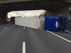 Lorry ends up on side on motorway