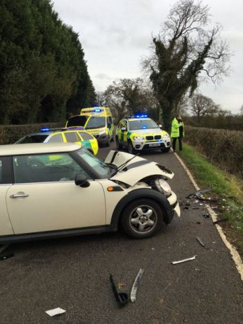 ONE CAR ENDS UP IN FIELD FOLLOWING COLLISION 1