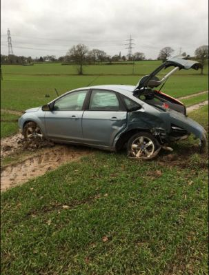 ONE CAR ENDS UP IN FIELD FOLLOWING COLLISION 2